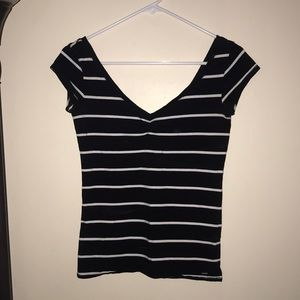 Low cut black and white striped T-shirt.